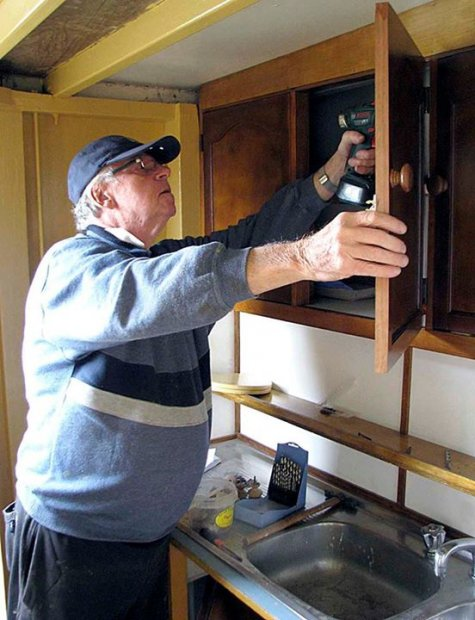 On a cold wet day in winter there could be no better place to be than refurbishing the cabinets in the galley. Marc's a craftsman.