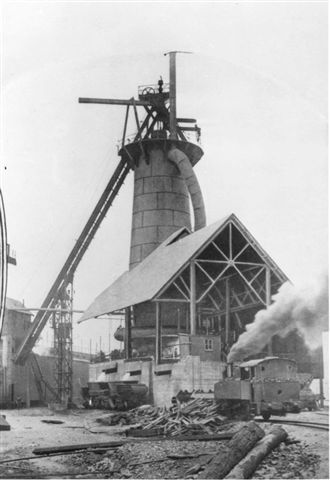 Newcastle BHP first Blast Furnace, notice the Slag Pots on the side of Furnace. The Steam Loco is waiting while they are being loaded with slag: