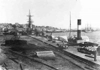 From the 1860's the foreshore was filled and new wharfs constructed. This is Queens Wharf looking west.